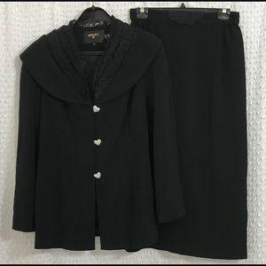 Women's black skirt suit size is 12 Louise Ricci.